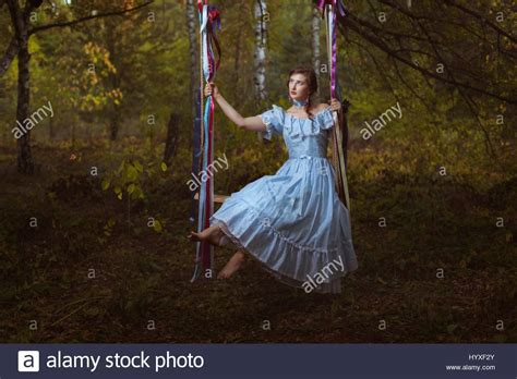 women and swinging girl swinging on a swing in the woods her vintage retro