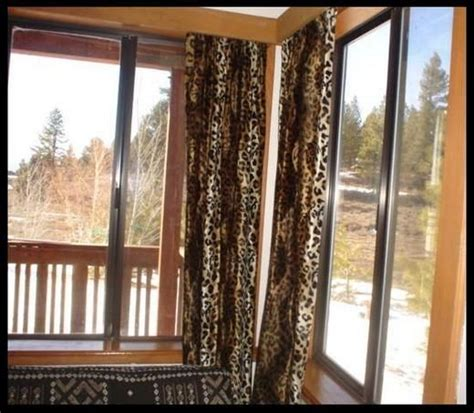 animal print window curtains decorating a bedroom in animal print interior home