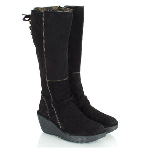 fly black yust s wedge knee high boot