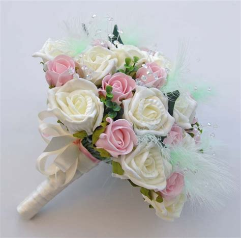 light pink and ivory wedding bouquets bridal bouquet in ivory and pink roses with light green