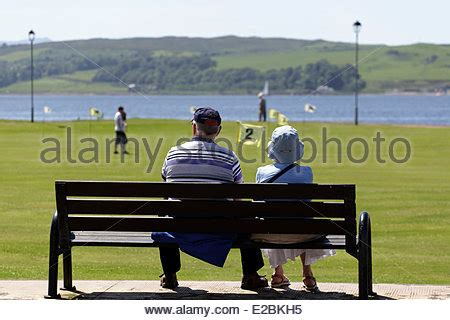 bench couple watch people on bench stock photos people on bench stock