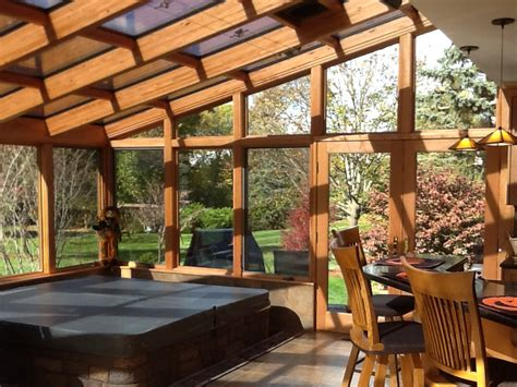 deck leads to four seasons room denbesten real estate sunrooms conservatories solariums greenhouses pool