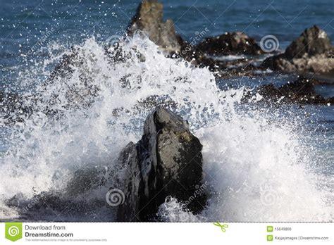 waves breaking  rocks stock photo image  pressure