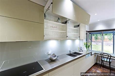 bifold kitchen cabinet doors a simple sleek and streamlined designer kitchen