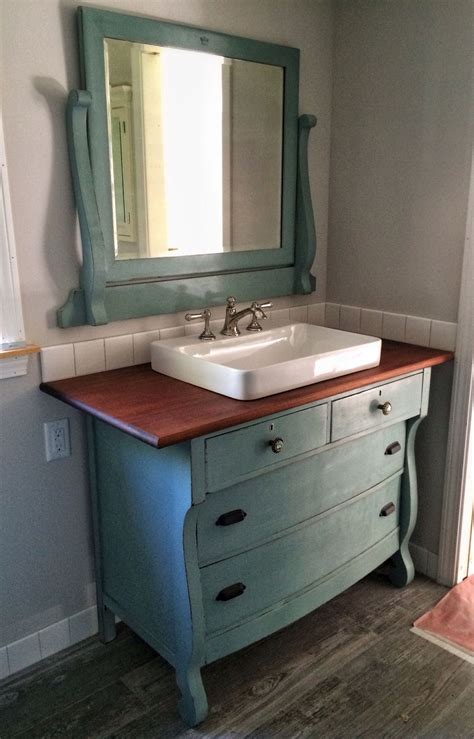 i just repurposed an dresser to use as a vanity in our