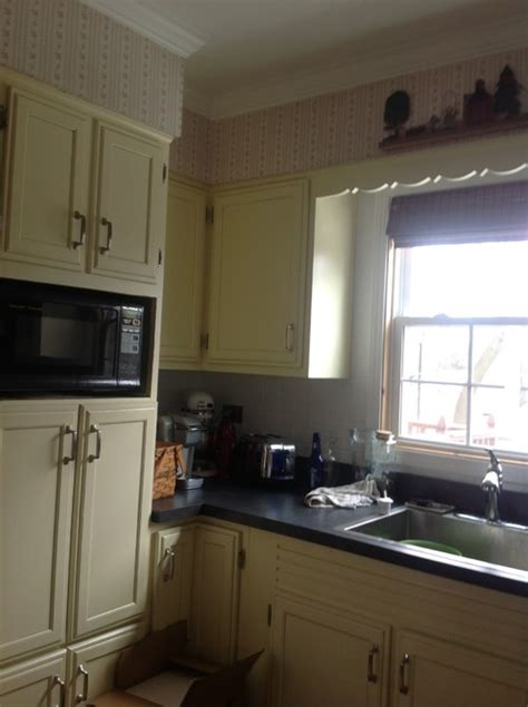 yellow kitchen cabinets what color walls need kitchen wall color to tone down yellow cabinets