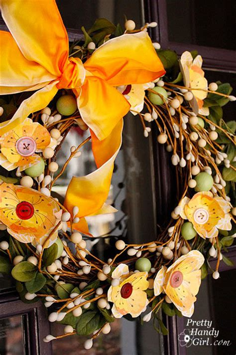yellow paper flower wreath tutorial inserting spring into my wreath pretty handy girl