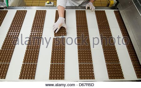 Employee Background Check Company An Employee Checks Chocolate Bars From Chocolate Manufacturer Ritter Stock Photo