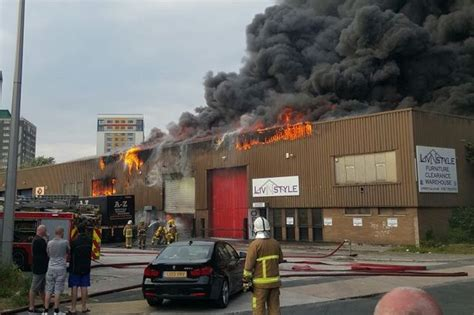 liverpool sofas warehouses fire engulfs bootle warehouse sending plumes of smoke