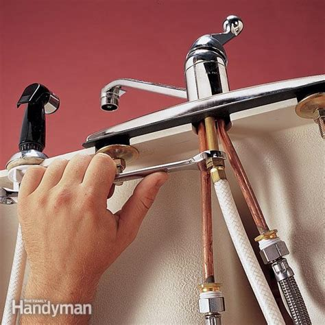 How To Stop A Leaky Kitchen Faucet replace a sink sprayer and hose the family handyman