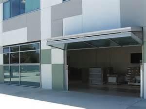 Overhead Bifold Doors Bifold Garage Doors Happy Work Place Garage Photos And Shades