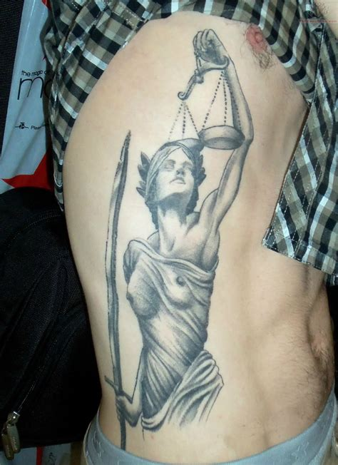 lady justice tattoo justice and scales on rib
