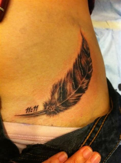 feather memorial tattoo 39 beautiful feather hip tattoos