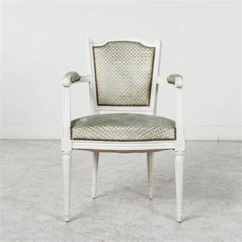 set of louis xvi style dining chairs painted white with