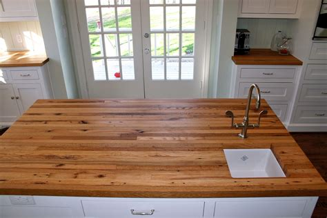 reclaimed oak wood countertop for square white kitchen