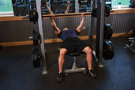 smith machine vs bench smith machine bench press exercise guide and video