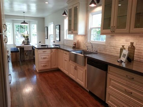 antique white kitchen cabinets with quartz countertops antique white kitchen antique white cabinets jeffrey