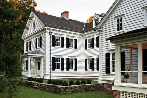 Clapboard House by An New Federal House