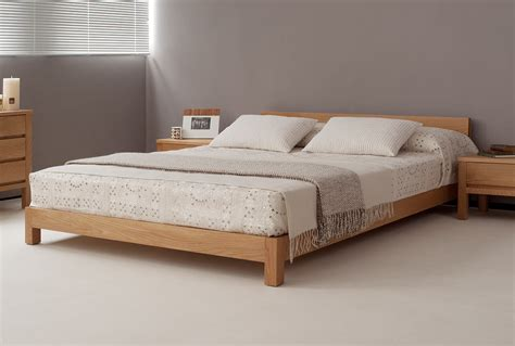 Solid Wood Bed Frame A Solid Wood Bed Frame Combines Traditional Med Home Design Posters