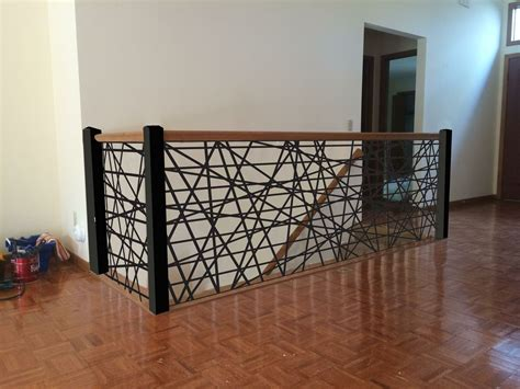 Interior irregular pattern banister staircase design decorative staircase as dramatic accent