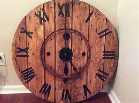 hometalk diy large cable spool wall clock