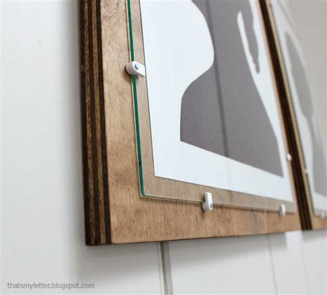 cheriesparetime frame a mirror with clips use low voltage wire clips in lieu of chunky glass clips