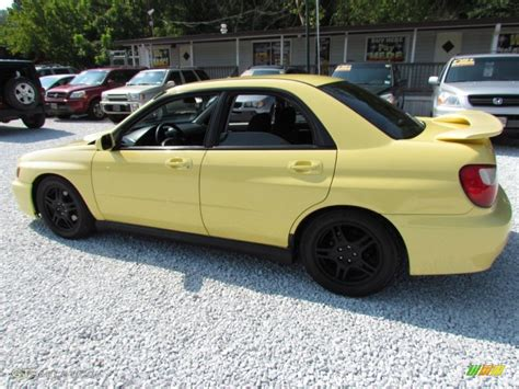 yellow subaru wrx 2002 blaze yellow subaru impreza wrx sedan 68830219 photo