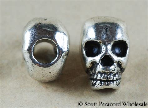 skull bead silver metal alloy smaller bead vertical