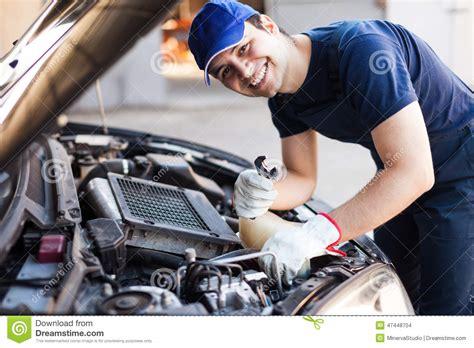mechanic fixing a car engine stock photo image 47448704