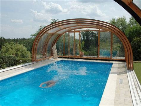 covered swimming pool indoor swimming pools and pool enclosures add luxury to