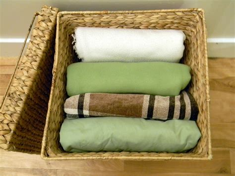 how to store pillows small rattan blanket storage basket for small living room