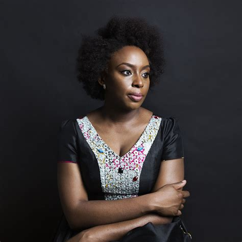 Fashion Feature 2 by Chimamanda Adichie In A Black And Print Dress For Wall
