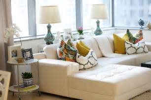 how to place pillows on a sectional white leather sectional eclectic living room caitlin