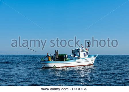 Commercial Background Check Small Commercial Fishing Boat With Fisherman At The Helm Newquay Stock Photo Royalty