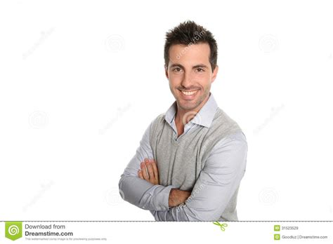 this is one happy guy this is the happiest man that i happy man standing wit arms crossed royalty free stock