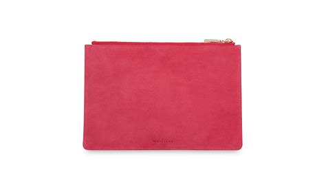 the pink clutch a small space with a big statement suede small clutch pink whistles