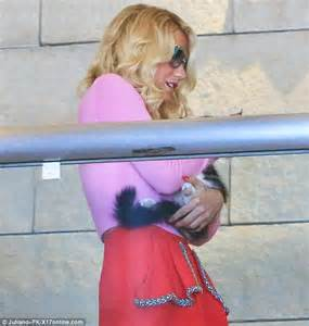 and kesha carry pet cats as they out on