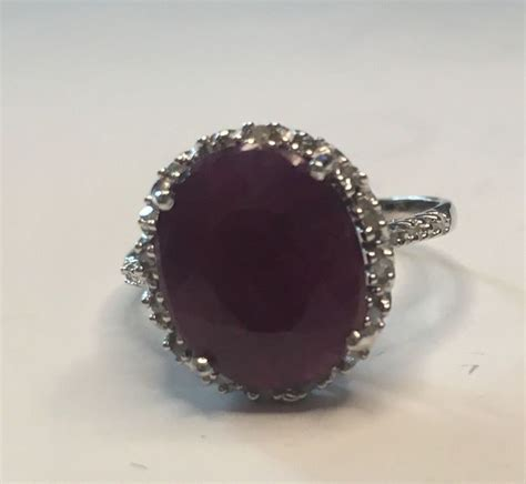 Ruby 14 1ct 14k gold ring with ruby and diamonds 0 1ct total 12x