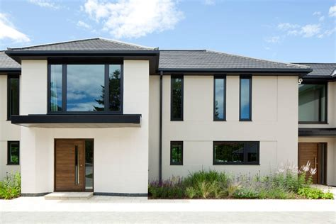 Modern House Windows Ideas Black Window Trim Exterior Contemporary With Oversized Window Beige Stucco Siding Exterior