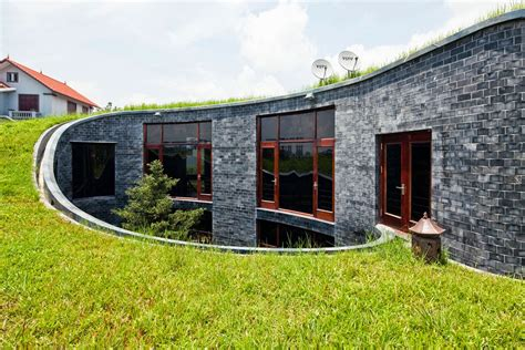 home granite stone house with grass roof and central garden modern