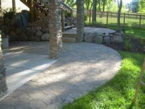 arbel paver s used to extend a concrete patio for the home concrete patios