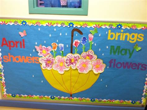educational themes for april april may bulletin board flowers made by hand prints