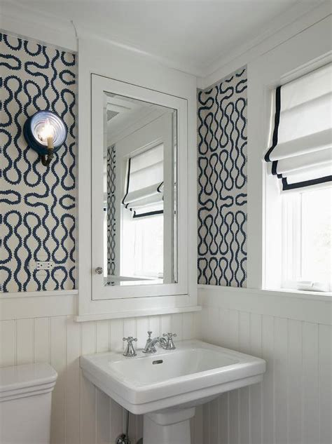 White and Navy Blue Powder Room with Yellow Accents