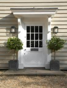 plants for outside front door dp022 06 white front door with pot plants clapperbo
