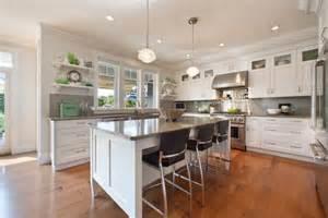White kitchen cabinets quartz countertop color gray wood flooring
