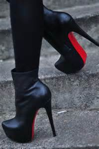 High heeled black leather ankle boots with red soles look sexy and