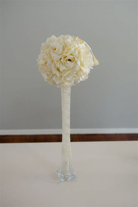 diy eiffel tower centerpiece with flower wrapped in