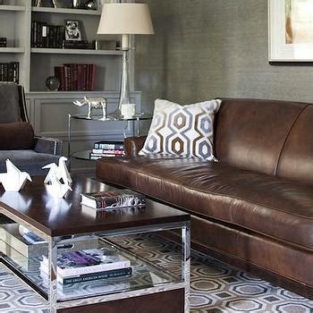 rug  brown sofa layered area rug  carpet  living