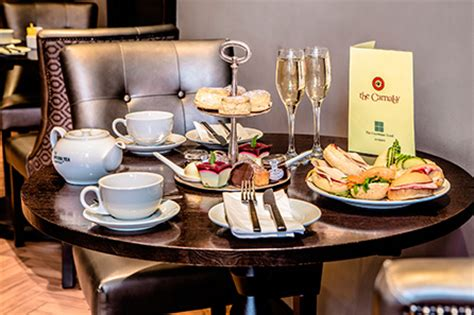 thames river cruise afternoon tea review view from the shard chagne afternoon tea at a luxury