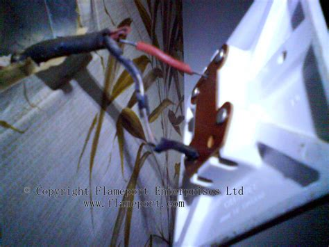 exposed live wire lighting wiring with failed rubber insulation